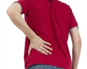 Man is having a lower back pain, isolated on white background